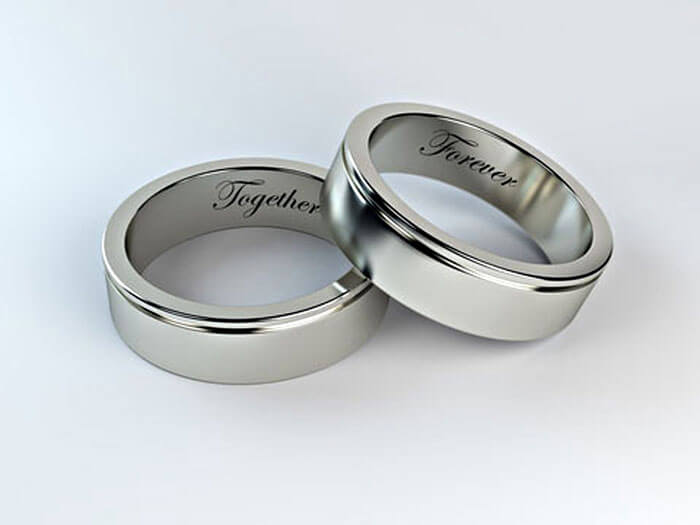 Together Forever engraving done on two white gold rings. Jewelry engraving services.