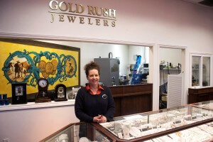 Woman standing smiling at Gold Rush Jewelers in Novato, CA