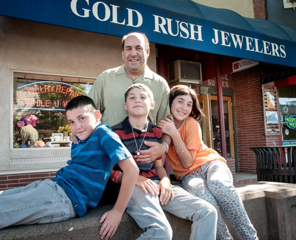 Family in front of Gold Rush Jewelers in Santa Rosa, CA