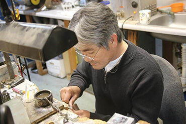 Bau Tran, jeweler working at Gold Rush Jewelers in San Rafael