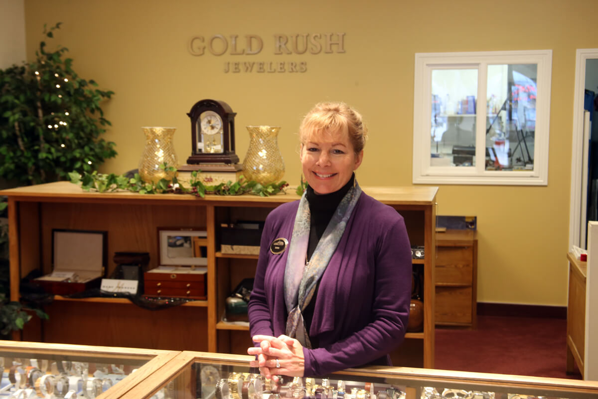 Woman standing smiling at Gold Rush Jewelers in Petaluma, CA.