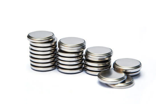 Coin watch batteries stacked for replacement