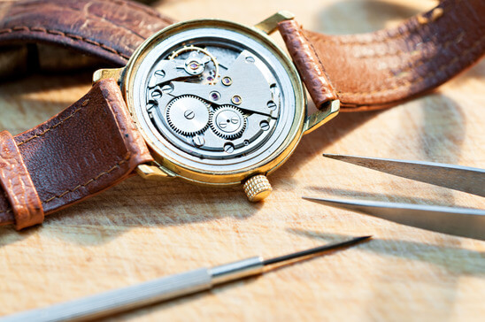 Leather wristwatch being repaired