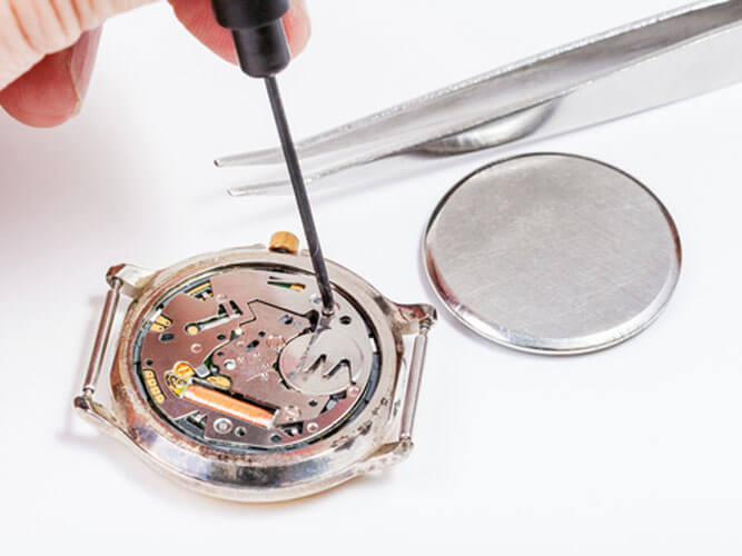 Jeweler performing a watch battery replacement