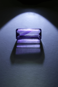 Faceted amethyst with color zoning